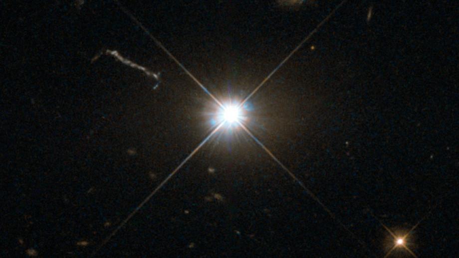 Ilustrativní jasný kvasar zhlubokého vesmíru. Kredit: ESA/Hubble & NASA.