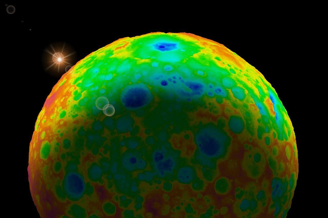 Topografická mapa trpasličí planety Ceres. Zdroj: https://cdn1.vox-cdn.com