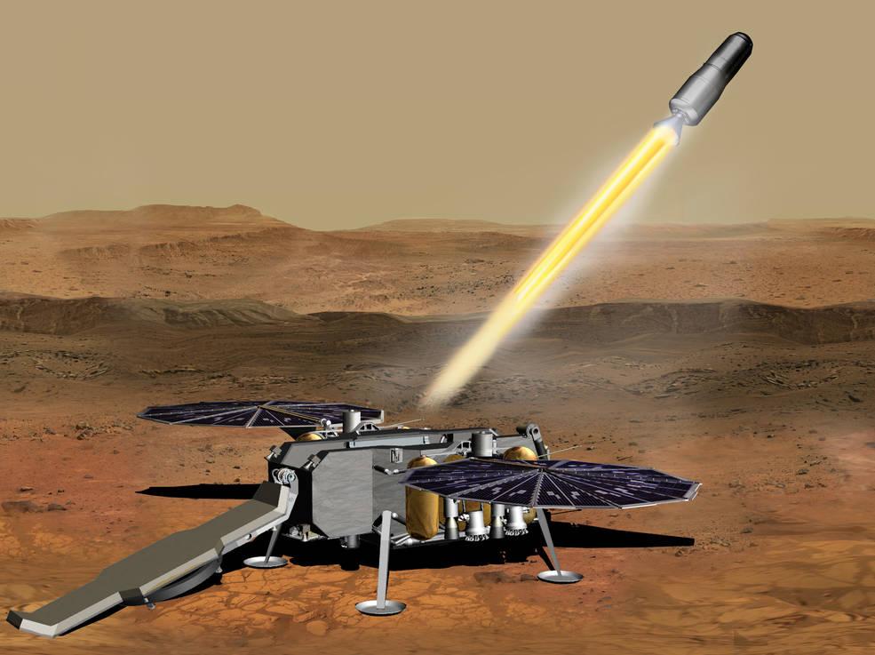 Umělecká představa startu transportního pouzdra, které dopraví nashromážděné vzorky z povrchu Marsu na orbitu okolo něj (zdroj NASA/JPL-Caltech).