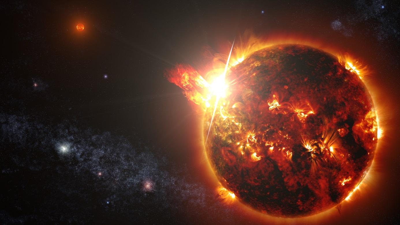 Umělecká představa velmi mladého binárního systému dvou červených trpaslíků DG CVn v okamžiku jedné ze supererupcí, která byla pozorována v dubnu 2014 a byla 10 tisíckrát větší než největší pozorovaná u Slunce. Systém je vzdálen 60 sv. let od Země. (