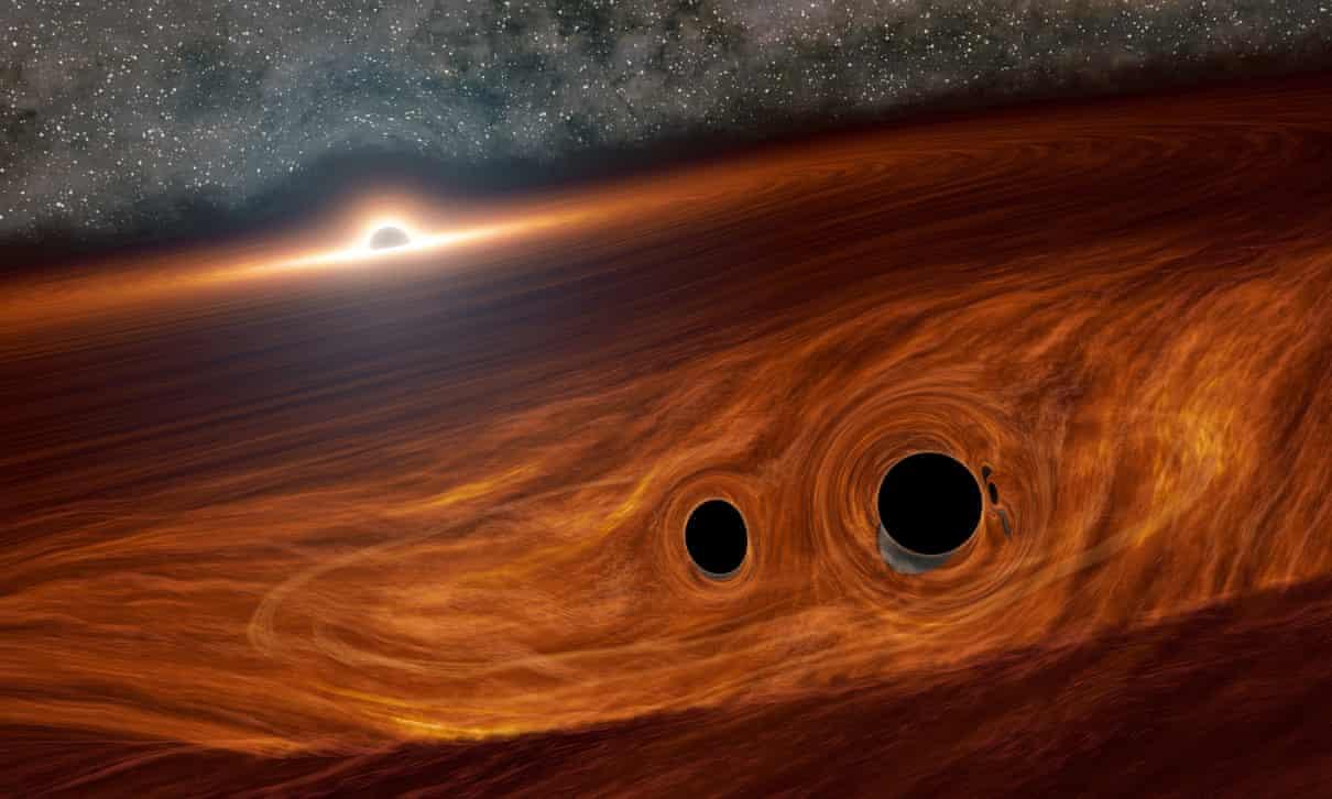 Srážka černých děr vakrečním disku. Kredit: R Hurt (IPAC)/Caltech.