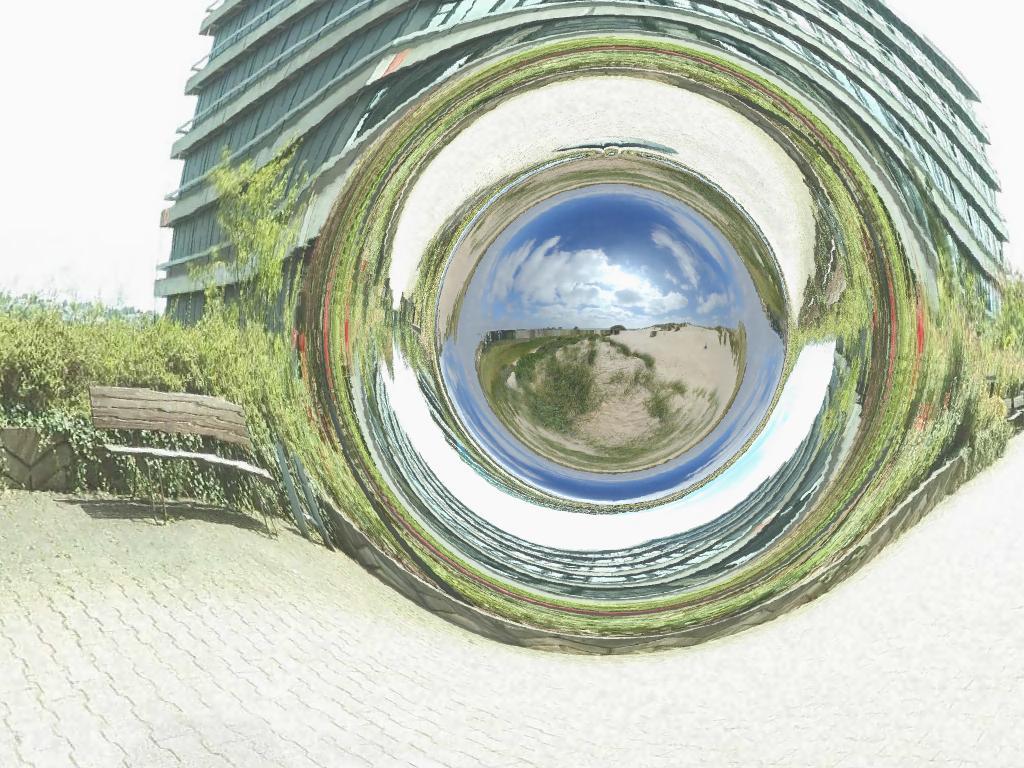 Simulovaná červí díra, která vede zněmeckého Tübingenu kpísečným dunám u Boulogne sur Mer na severu Francie. Kredit: CorvinZahn / Wikimedia Commons.