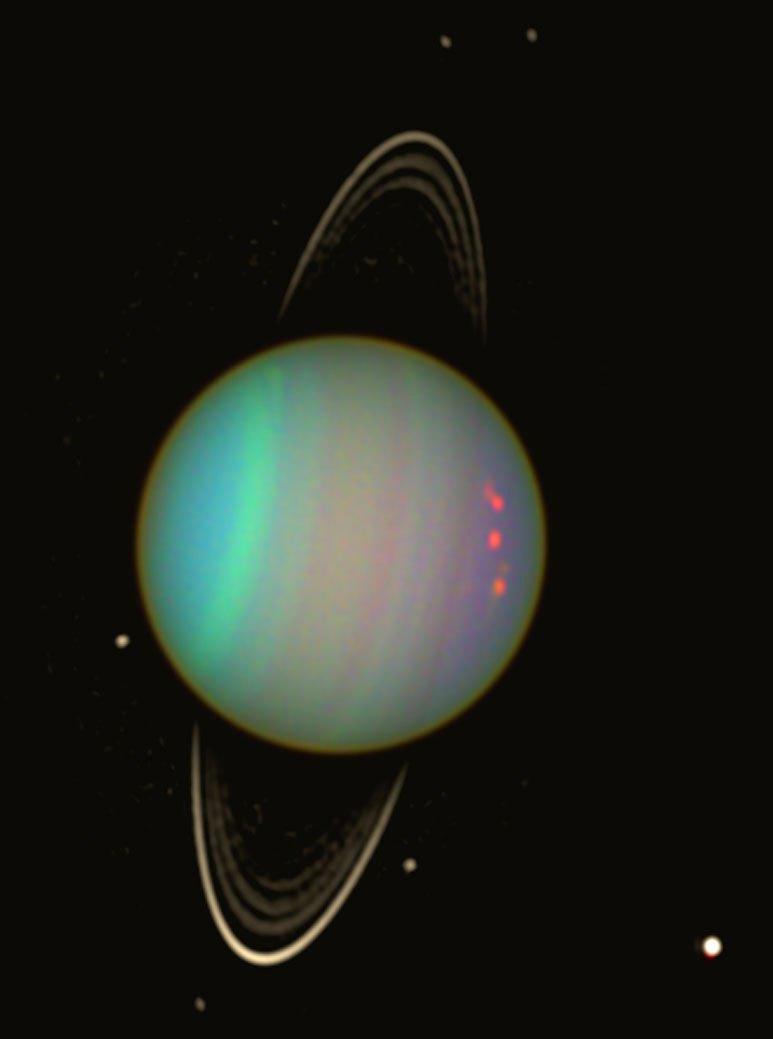 Uran ve falešných barvách pohledem Hubbleova teleskopu v roce 2003. Zdroj: http://www.nasa.gov/