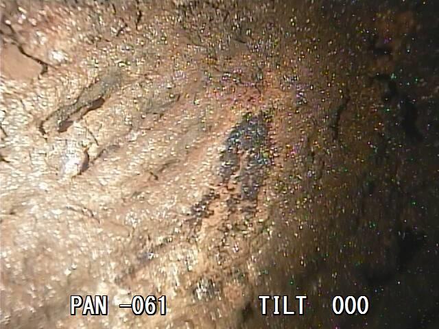 Zničená a roztavená část roštové podlahy (zdroj TEPCO)