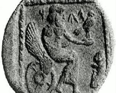 Jahve sedící na okřídleném kolečkovém křesle. Stříbrná drachma, 4. století před Kristem. (Foto: Arthur B. Cook, Kredit: Eickenberg at en.wikipedia)