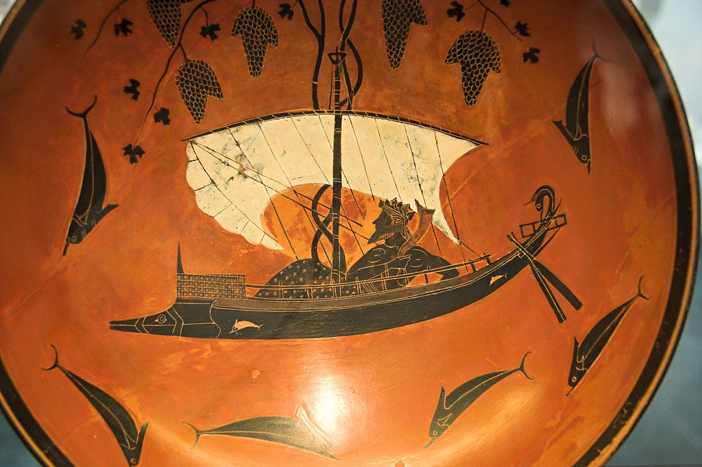 Dionýsos na lodi. Kylix z Vulci, malíř Exekiás, kolem roku 530 př. n. l. Staatliche Antikensammlungen München. Kredit: Zde, Wikimedia Commons. Licence CC 3.0.