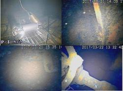 Záběry z průzkumu prvního bloku v březnu 2017. Vlevo nahoře je pohled na robota zahajujícího průzkum. Další tři záběry ukazují detaily pod vodou na dně kontejnmentu (zdroj TEPCO).