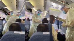 Čínští zdravotníci pátrají po nemocných vletadle. Kredit: David Paulk/Twitter.