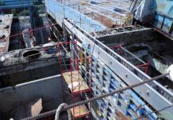Další záběr na průběh prací s budováním koncové stěny (zdroj Černobylská jaderná elektrárna).