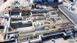Práce na budování závodu pro plnění obalových souborů a přípravu odpadu pro uložení (zdroj Posiva).