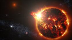 Umělecká představa velmi mladého binárního systému dvou červených trpaslíků DG CVn v okamžiku jedné ze supererupcí, která byla pozorována v dubnu 2014 a byla 10 tisíckrát větší než největší pozorovaná u Slunce. Systém je vzdálen 60 sv. let od Země. (Zdroj NASA Goddard Space Flight Center/S. Wiessinger).