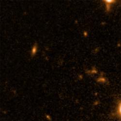Na snímku je jeden ze dvou kandidátů na zárodek supermasivní černé díry. Kredit: NASA / STScI / ESA.