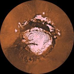 Zvoní jim hrana? Severní polární čepička Marsu. Kredit: NASA / JPL / USGS.