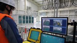 Zácvik operátorů miniponorky určené pro průzkum bazénu druhého bloku v laboratořích ve městě Minami-Soma (zdroj TEPCO).