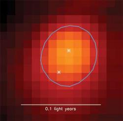 Rádiový snímek dvojice velice mladých hvězd vmolekulárním mračnu. Kredit: SCUBA-2 survey image by Sarah Sadavoy, CfA.