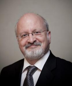 Germain Belzile  je makroekonomem na instituci s příznačnou zkratkou HEC Montréal.  Kredit: Université du Québec à Montréal.