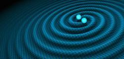 Binární neutronová hvězda těsně před splynutí rozvlní prostoročas (zdroj R. Hurt/Caltech-JPL).