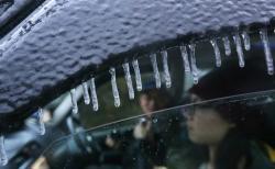 Motoristé v ostřikovačích nemrznoucí směs neznají. Kredit: Felix Wong