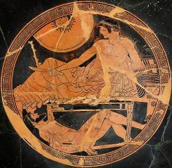 Achilleus uchovává tělo zabitého Hektora, aby mohl vyjednávat o jeho výměně za tělo padlého Patrokla. Atický červenofigurový pohár, 490-480 před n. l. Louvre, G 153. Kredit: Marie-Lan Nguyen, Wikimedia Commons. Public domain.
