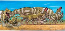 """Mnozí dinosauři byli zřejmě pohybliví živočichové s aktivním metabolismem a schopností rychlé lokomoce. Zde stádo migrujících kachnozobých lambeosaurů a ceratopsidů styrakosaurů, obtěžovaných smečkou velkých tyranosauridních teropodů. Zejména menší a středně velcí teropodi zřejmě dokázali vyvinout rychlost v běhu až přes 40 km/h. Kredit: Luis V. Rey, kniha """"Dinosaurs: The Most Complete, Up-To-Date Encyclopedia…"""" (převzato se svolením z webu L. Reye)"""
