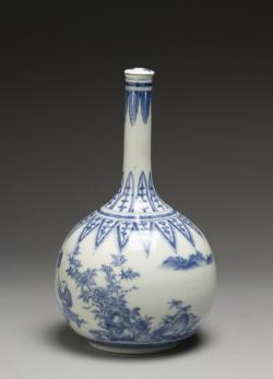 Tradiční láhev na saké. Pravému japonskému saké se říká Nihonšu. Vyrábí se ze speciální odrůdy rýže (sakamai). Uvařená zrna se nejprve musí infikovat plísní koji, jde o  Aspergillus oryzae (česky kropidlák), Plíseň štěpí škrob na cukry, které snadno kvasí. Proces výroby několikanásobnoufermentací se podobá výrobě piva. Asi nejvíc vešlo saké ve známost jako jako nápoj pilotůkamikaze. V anglosaských zemích se (kvůli výslovnosti) píše saké s čárkou. V češtině to máme tendenci vyslovovat dlouze. V zemi původu by vám po takové objednávce kýžený nápoj ale nedonesli. (Kredit:  Walters Art Museum).