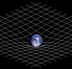 Zakřivení prostoru zemskou gravitací. Kredit: Johnstone, Wikimedia Commons.