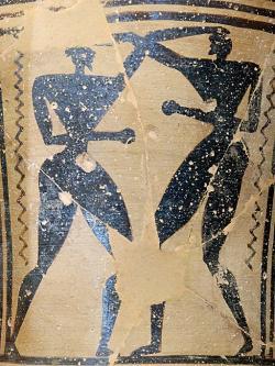 Zápasníci (boxeři?) na pozdně geometrickém fragmentu z Théb, 715-700 před n. l. Louvre, A 568. Kredit: Marie-Lan Nguyen alias Jastrow, Wikimedia Commons. Licence CC 2.5.