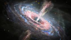 Galaxie srozjetým kvasarem září jako vánoční stromeček. Kredit: NASA, ESA, J. Olmsted (STScl).