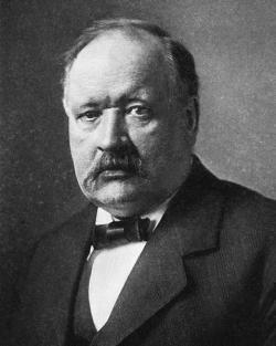 Svante Arrhenius,švédskýfyzikachemik, jeden ze zakladatelůfyzikální chemie v roce1895předpověděl vlivoxidu uhličitéhovznikajícího spalováním uhlí, na oteplování celé planety. Arrheniusovi byla za elektrolytickou teoriidisociace udělena Nobelova cena. Svou autoritou nobelisty se posléze zasadil o zřízení Státního institutu pro rasovou biologii propagujícího eugeniku.