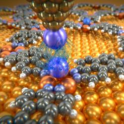 Van der Waalsovy síly mezi atomem xenonu na hrotu mikroskopu a atomem vzácného plynu vkelímku zatomů mědi. Kredit: University of Basel, Department of Physics.