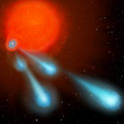 Červený obr s plazmovým dělem. Kredit: NASA, ESA, and A. Feild (STScI).