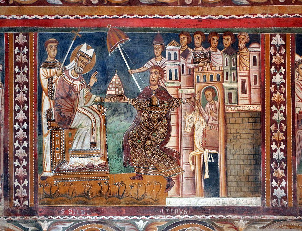 Papež Silvestr I. přijímá od císaře Konstantina darem kus Itálie a nadřazené postavení nad celou církví (obojí je nesmysl). Cappella di San Silvestro, roku 1246. Kredit: Sailko, Wikimedia Commons.