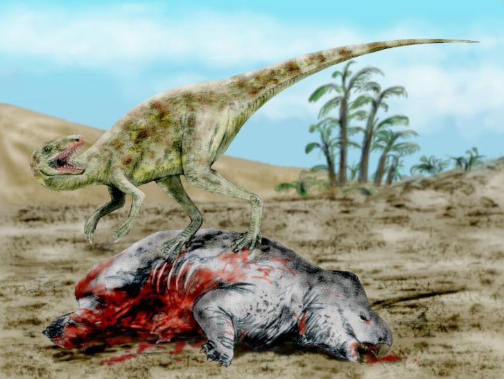 """Starobylý teropodní dinosaurusStaurikosaurus priceise svojí kořistí v podobě uloveného dicynodonta. Tito dinosauři žili zhruba před233 miliony leta patří tak k nejstarším známým """"pravým"""" dinosaurům vůbec.Kredit:Nobu Tamura, Wikipedie (CC BY 3.0"""